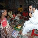 Baba-listening-intently-to-child...-GREAT-Copy.jpg